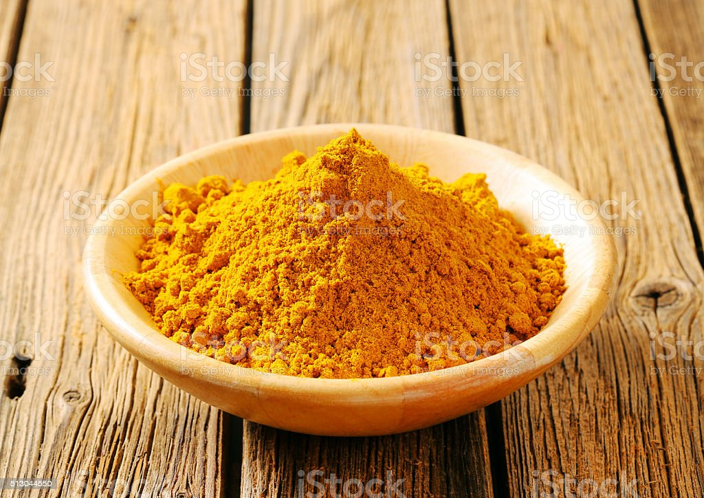 Heap of curry powder stock photo