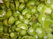 Heap of cut small green tomatoes