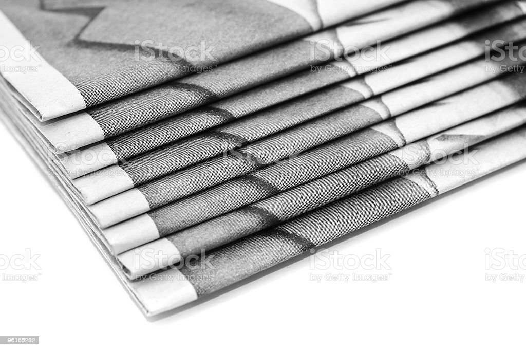 Heap of daily paper or newspapers over white royalty-free stock photo