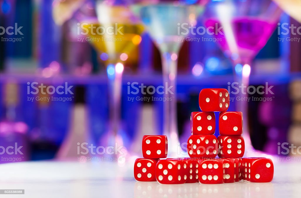 Heap of dices on the bar table stock photo