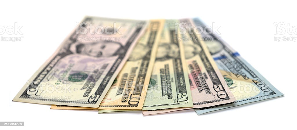 Heap of Dollar Bills isolated on white background stock photo
