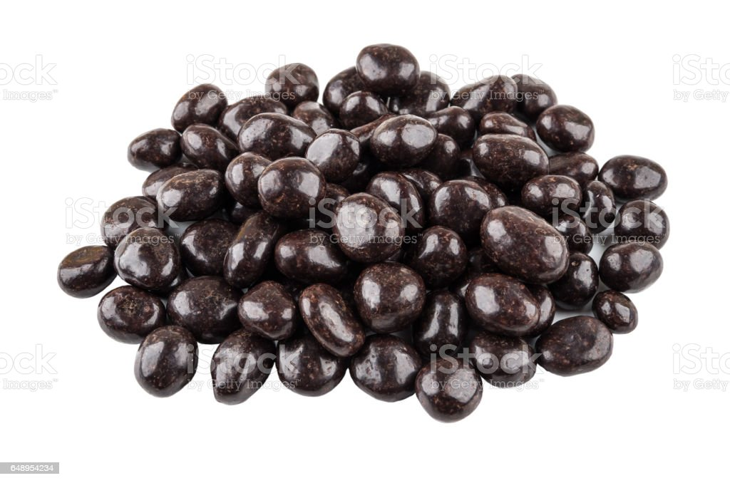 Heap of dragee raisins in powder cacao isolated on white stock photo