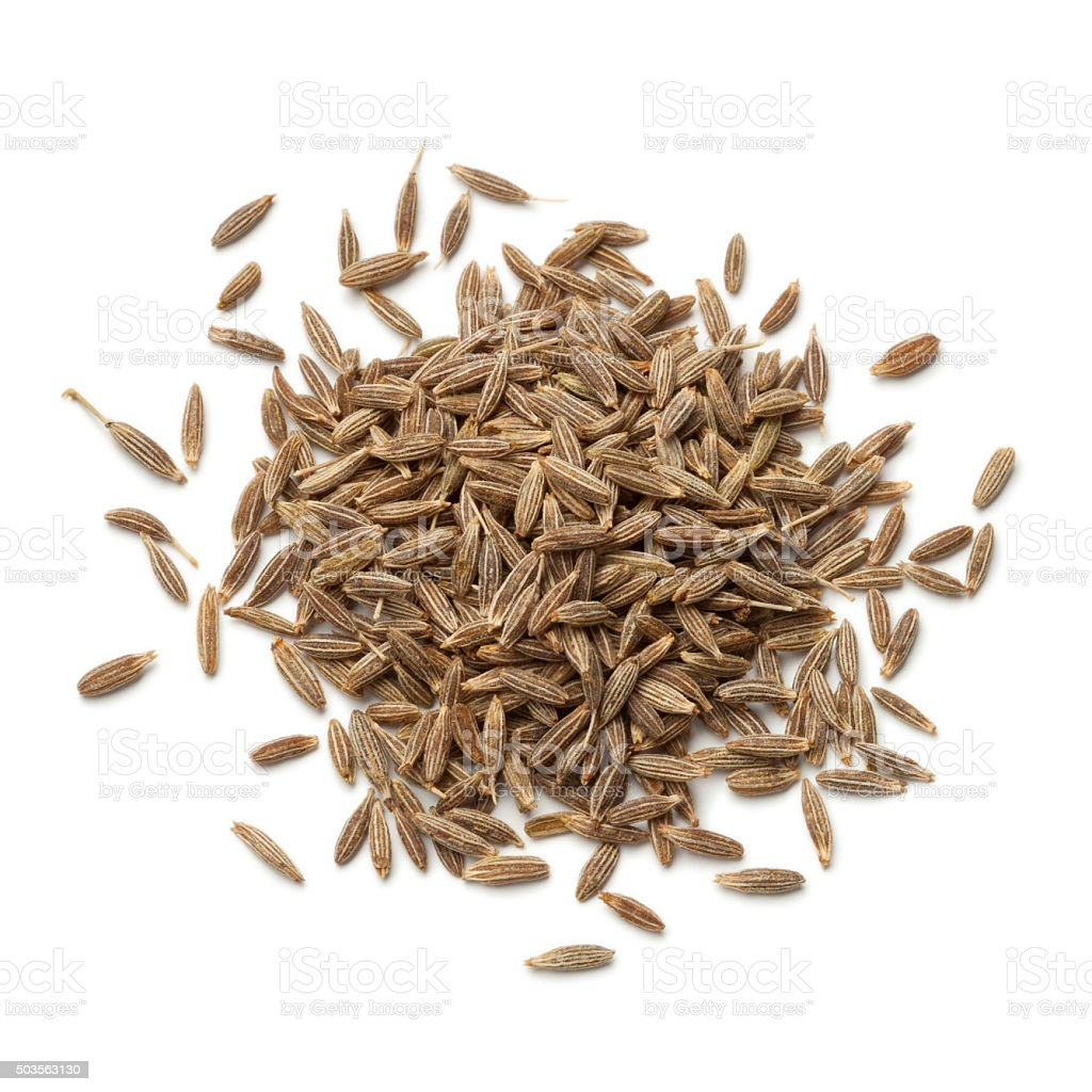 Heap of dried cumin seeds stock photo