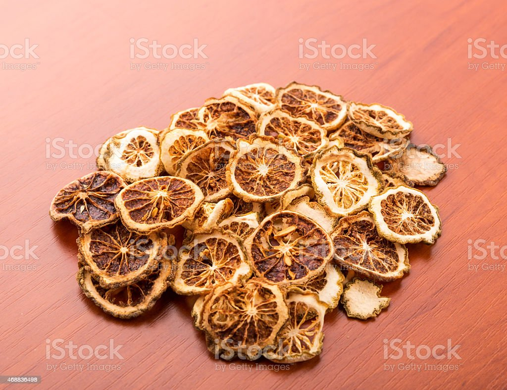 Heap of dried lime slices stock photo