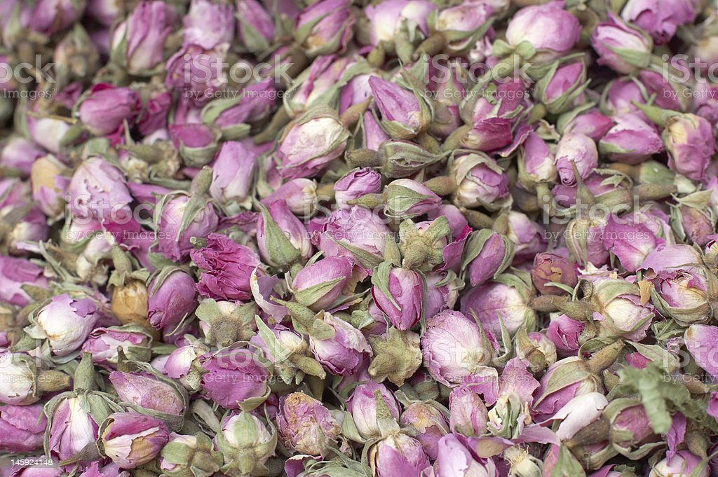 heap of dried roses at the market royalty-free stock photo