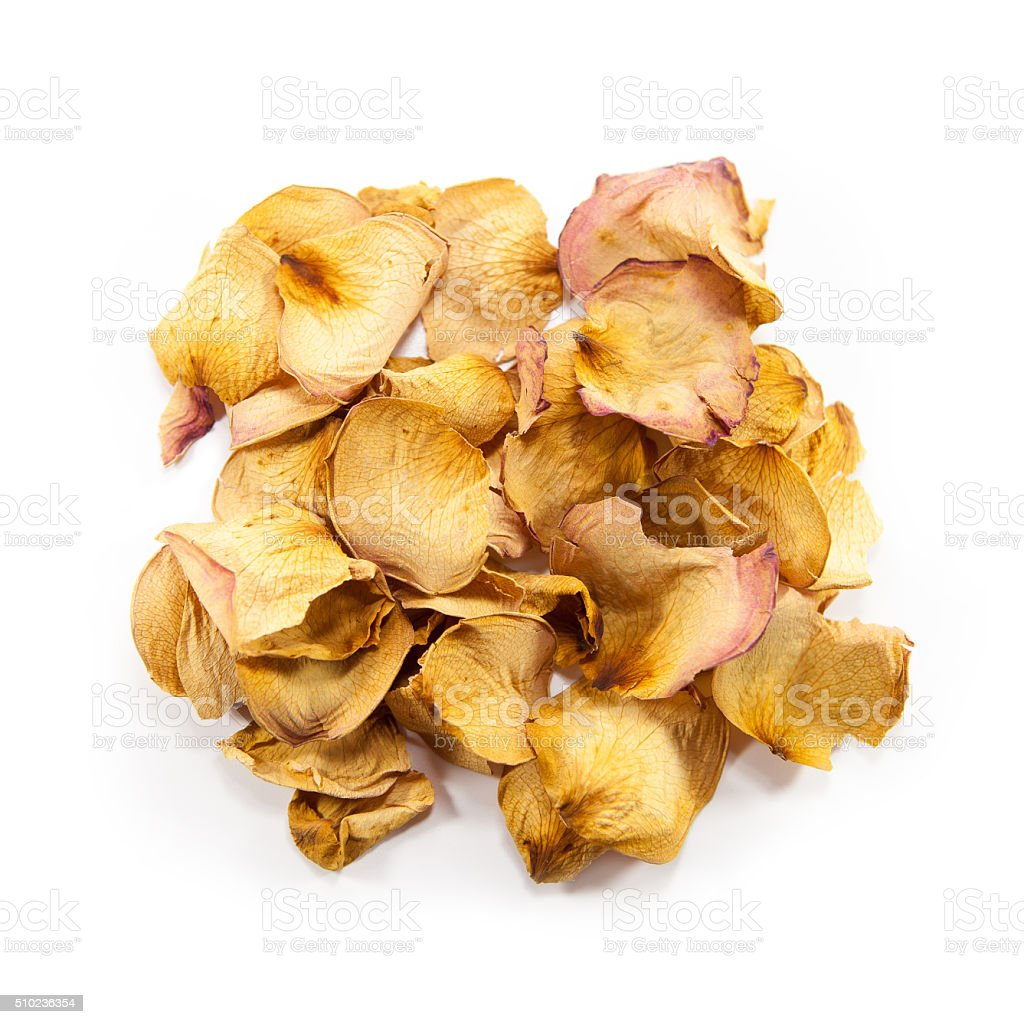 Heap of dried yellow rose petals stock photo