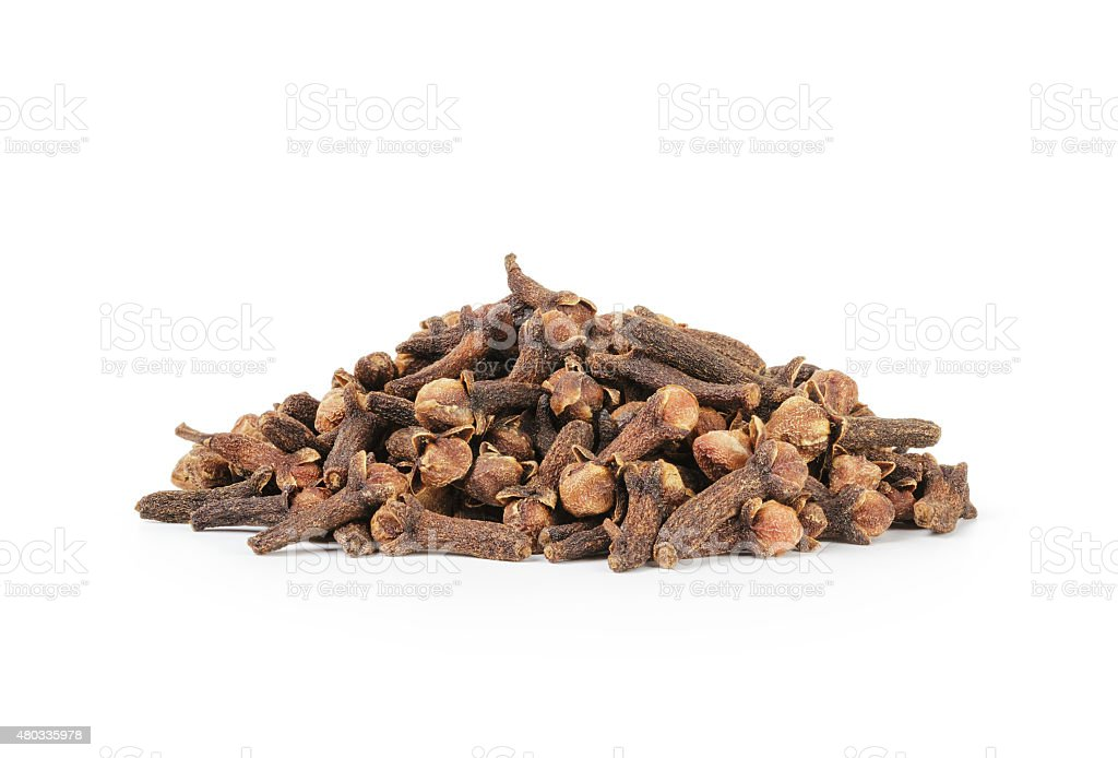 heap of dry cloves spice isolated on a white stock photo