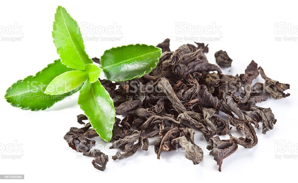 Heap of dry tea with green tea leaves. stock photo