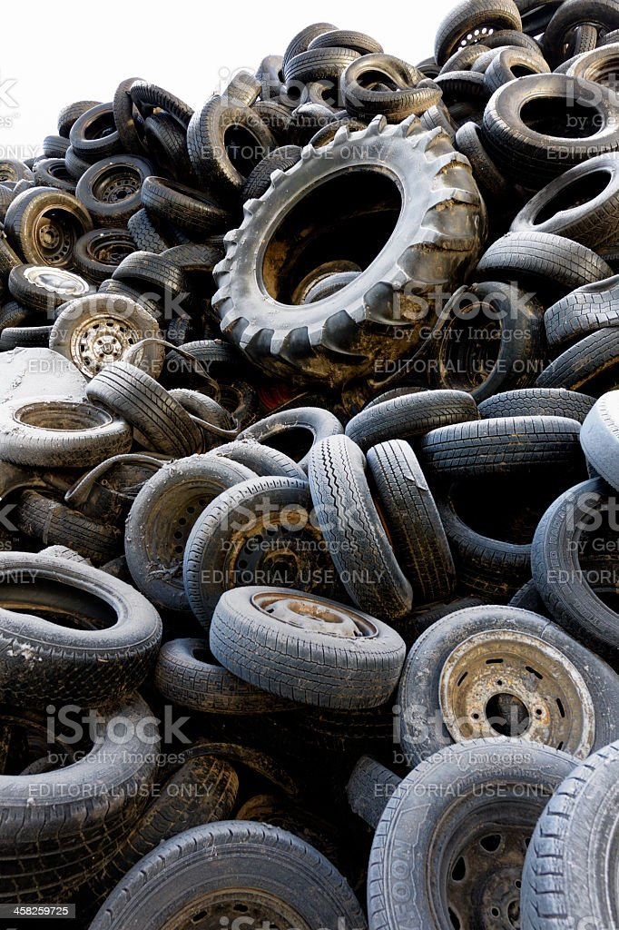heap of dumped tires stock photo