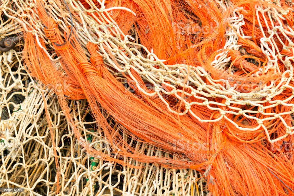 Heap of fishing nets and rope stock photo