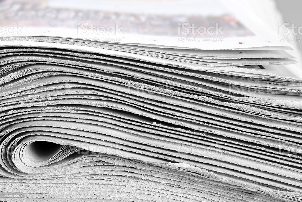 Heap of folded newspapers stock photo