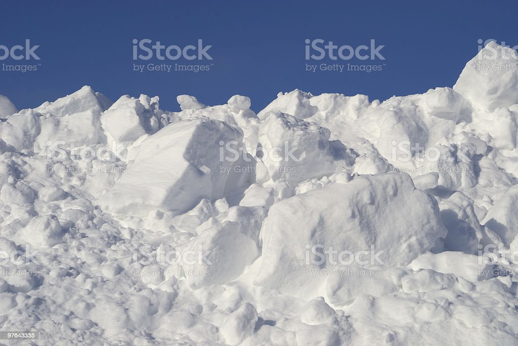 Heap of freshly fallen snow with blue sky royalty-free stock photo