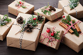 Heap of gift or present box wrapped in kraft paper.