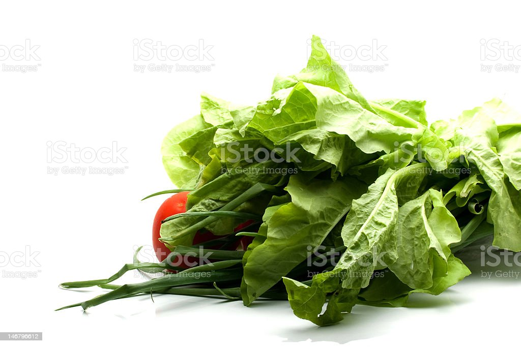 heap of green salad onion and tomatoes royalty-free stock photo
