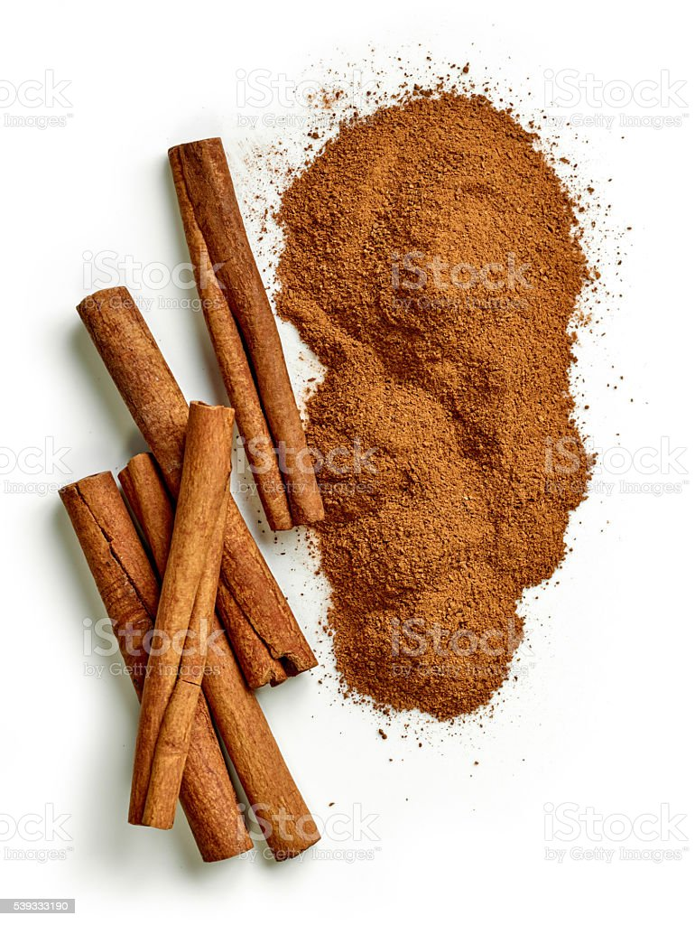 heap of ground cinnamon stock photo