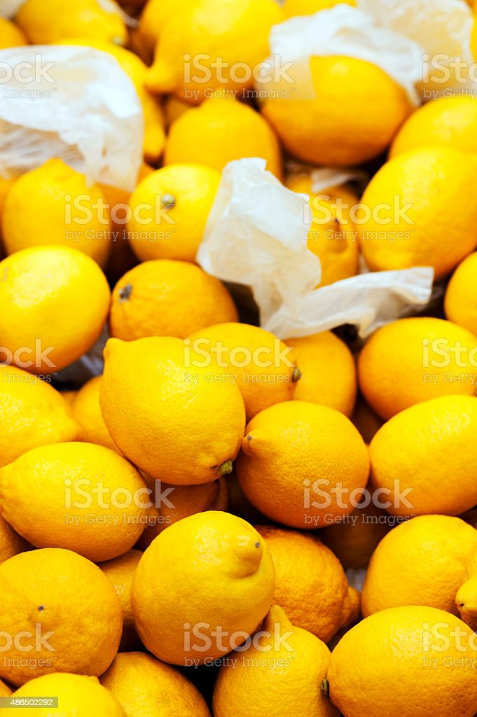 Heap of Lemons in market stock photo