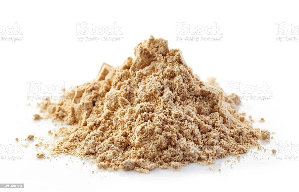 heap of maca powder stock photo