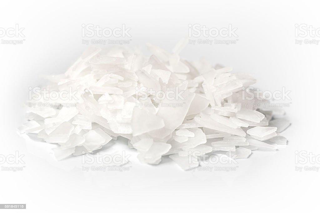 Heap of Magnesium Flakes on White background stock photo