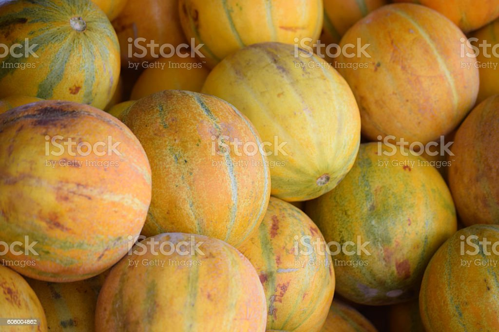 Heap of melons on the market and like a background stock photo