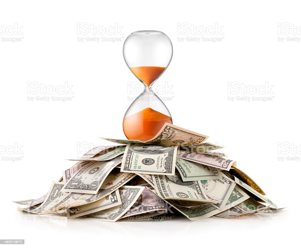 Heap of money with hourglass stock photo