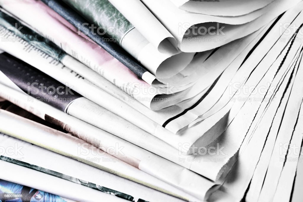 Heap of old newspapers stock photo