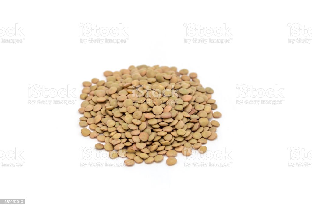 Heap of organic green lentils isolated on white background stock photo