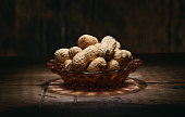 heap of peanuts on rustic wooden table