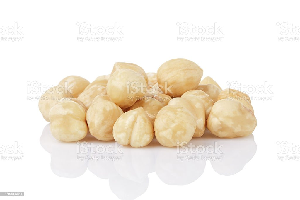 heap of peeled hazelnuts isolated stock photo