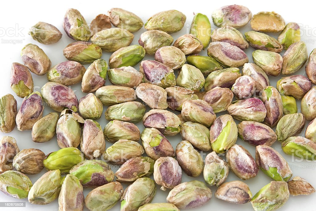 heap of peeled pistachios royalty-free stock photo