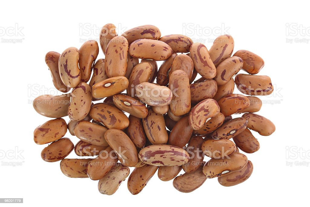 Heap of pinto beans isolated on white stock photo
