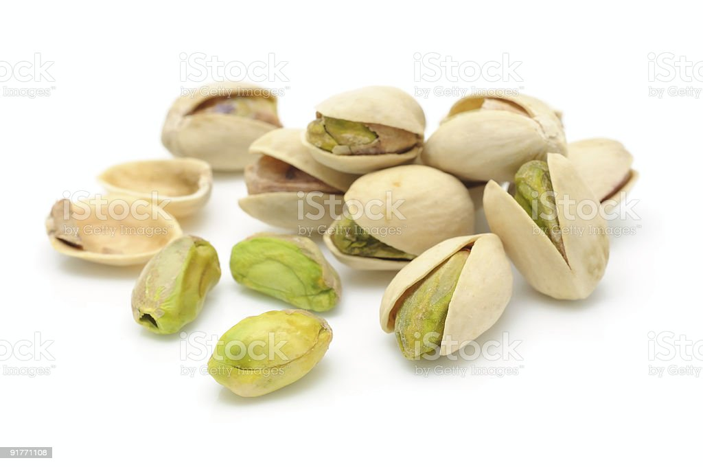 Heap of pistachios nuts stock photo