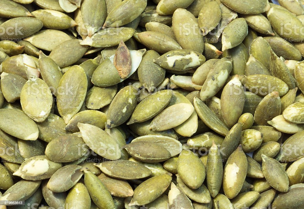 Heap of raw pumpkin seeds isolated background stock photo
