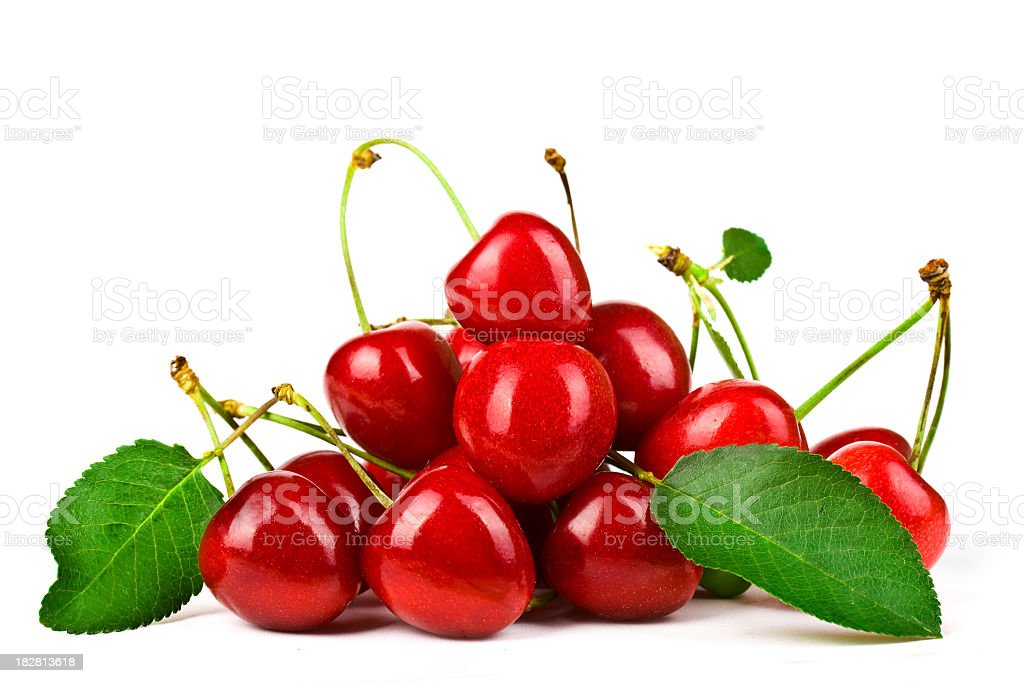 Heap of red cherries with leaves and stems stock photo
