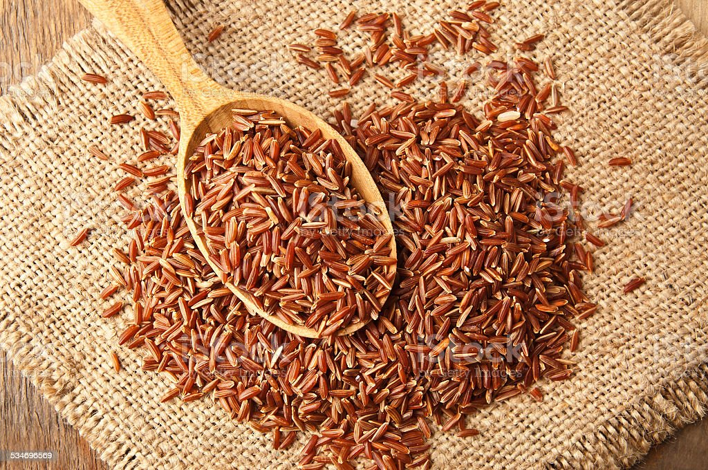 heap of red rice stock photo