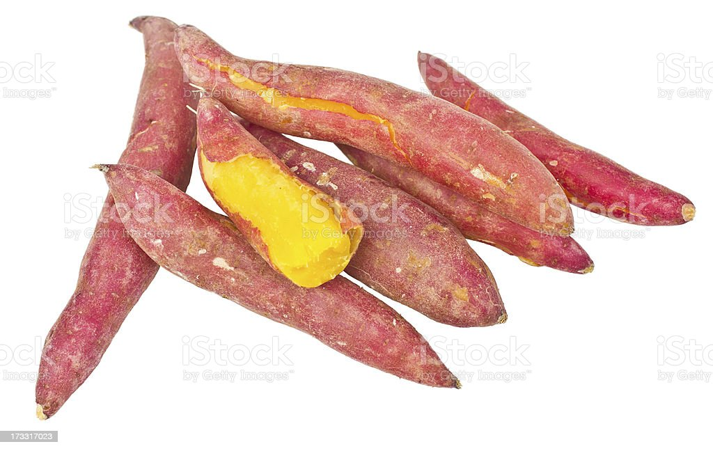 Heap of red yams. one root was peeled. royalty-free stock photo