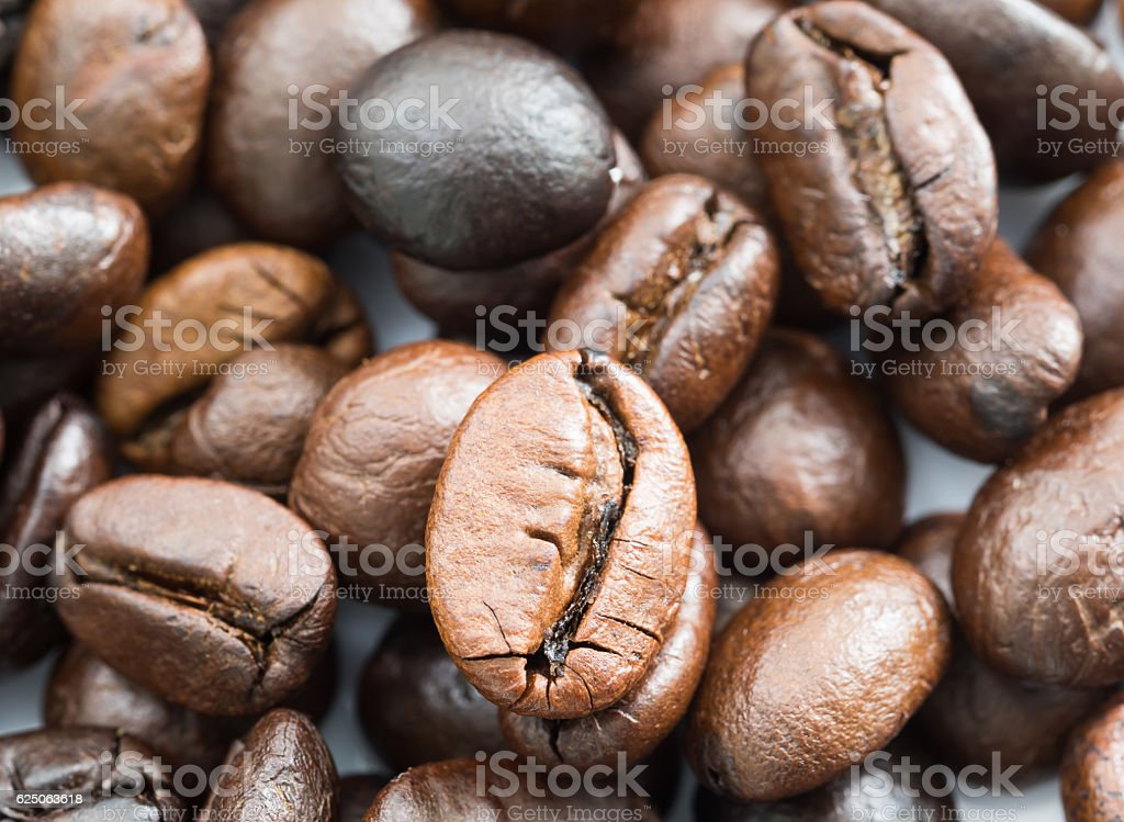Heap of roasted Roasted brown coffee beans stock photo