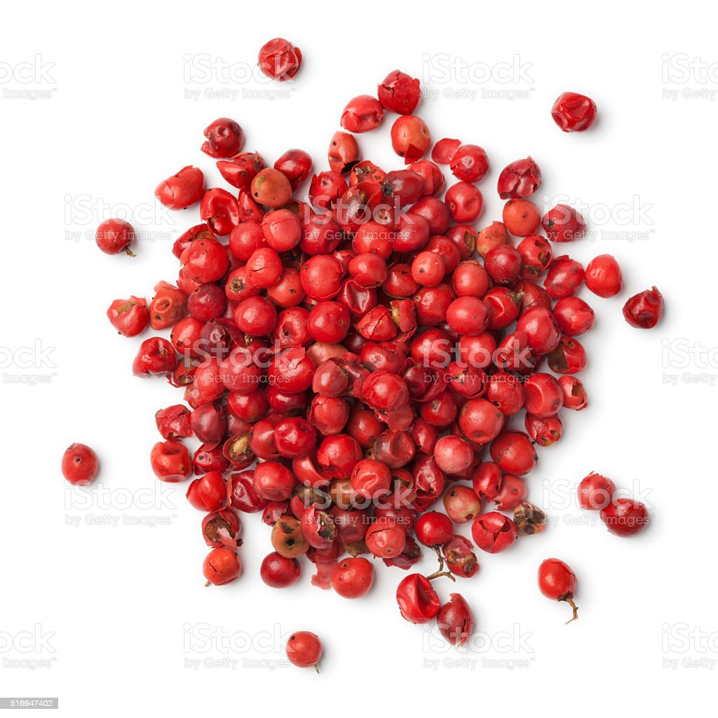 Heap of rose peppercorns stock photo
