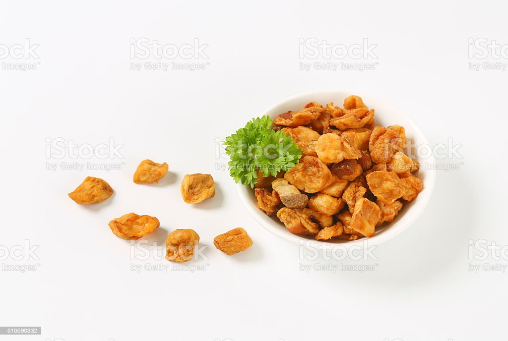 Heap of salty pork greaves (top view) stock photo