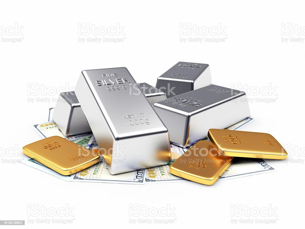Heap of silver and golden bars on dollar bills stock photo