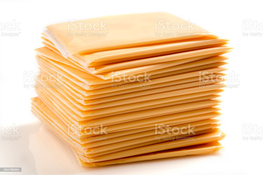 Heap of Sliced American Yellow Cheese stock photo