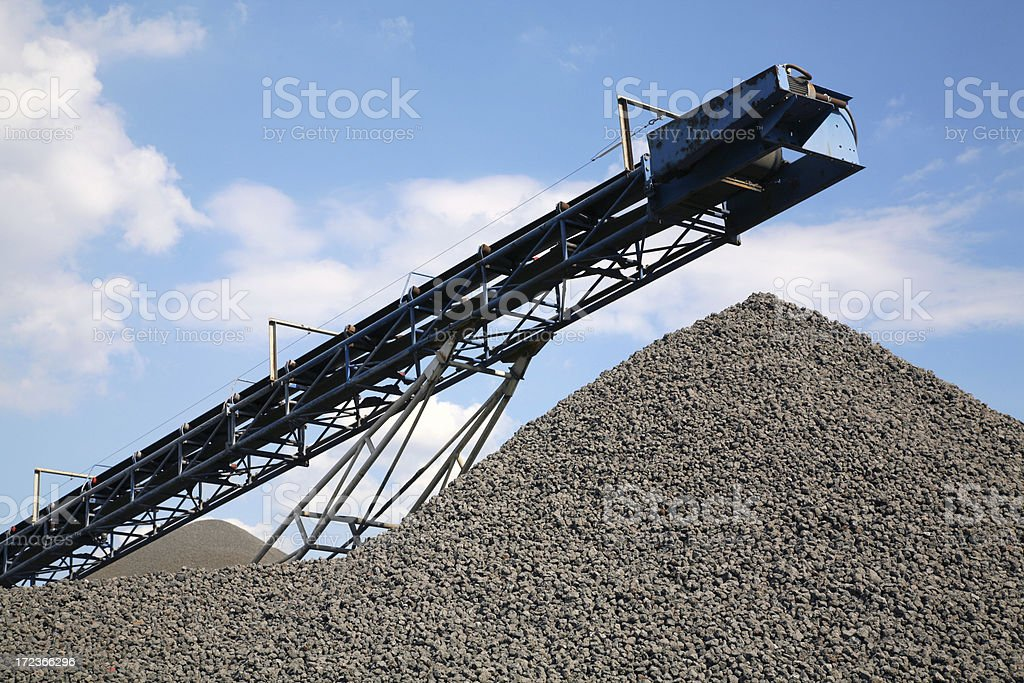 Heap of stones with conveyor belt royalty-free stock photo