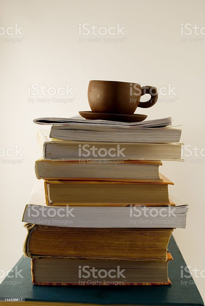 Heap of the book and cup royalty-free stock photo