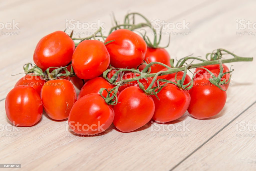 Heap of tomatoes on a wooden table stock photo