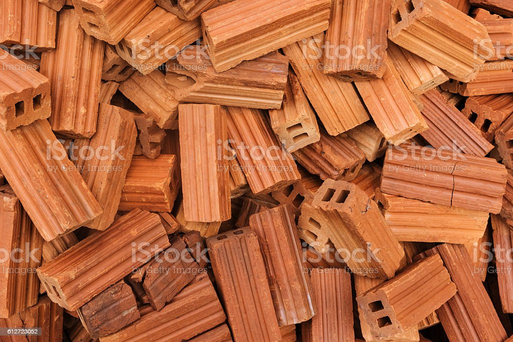 Heap of unarranged bricks for construction stock photo