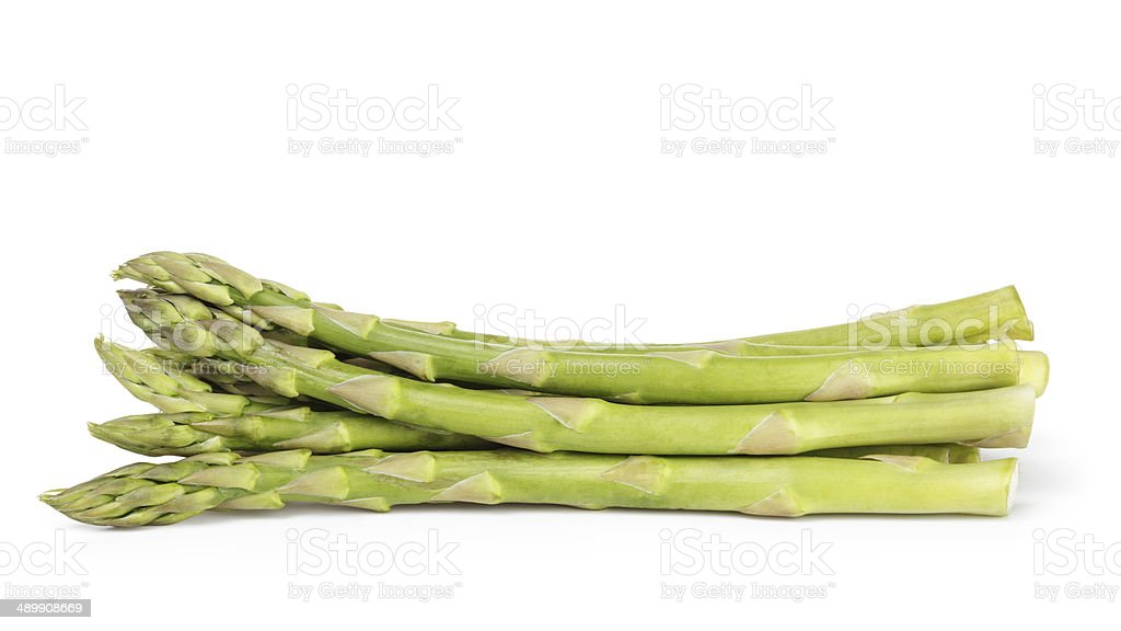 heap of uncooked green asparagus stock photo