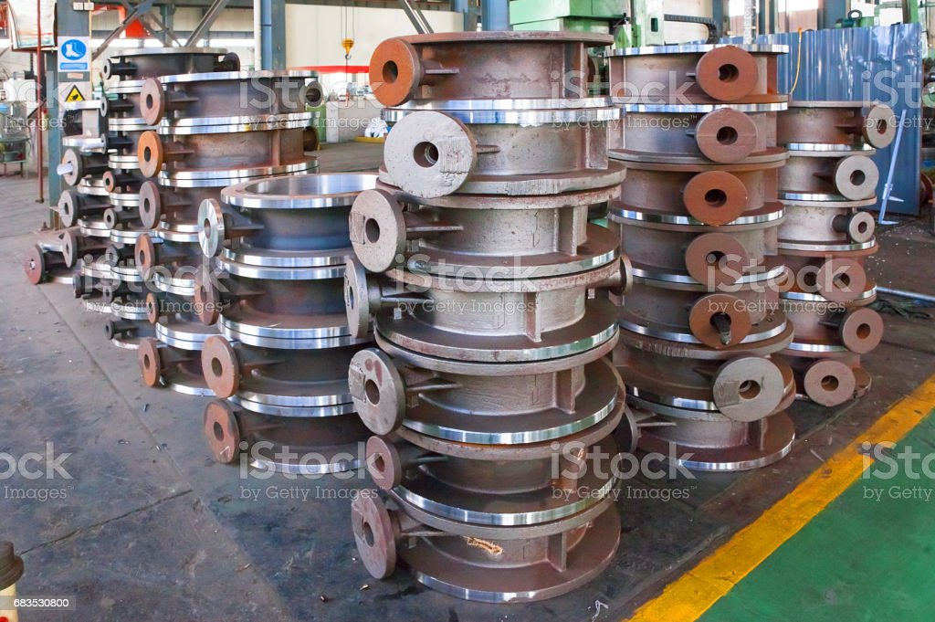 Heap of valve bodies spare parts prapared for mashining in factory. stock photo