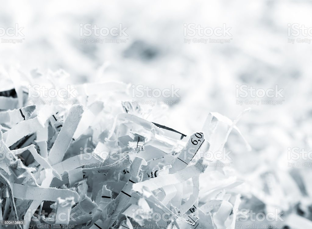 Heap of white shredded papers stock photo