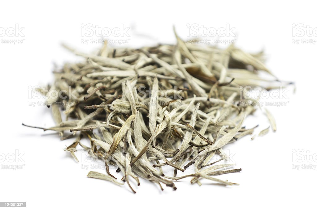 A heap of white tea leaves on a white background stock photo