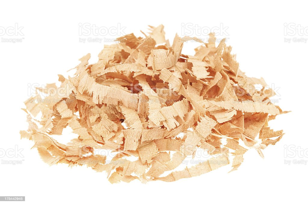 Heap of wood shavings isolated on white royalty-free stock photo