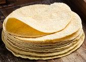 A heap of yellow corn tortillas